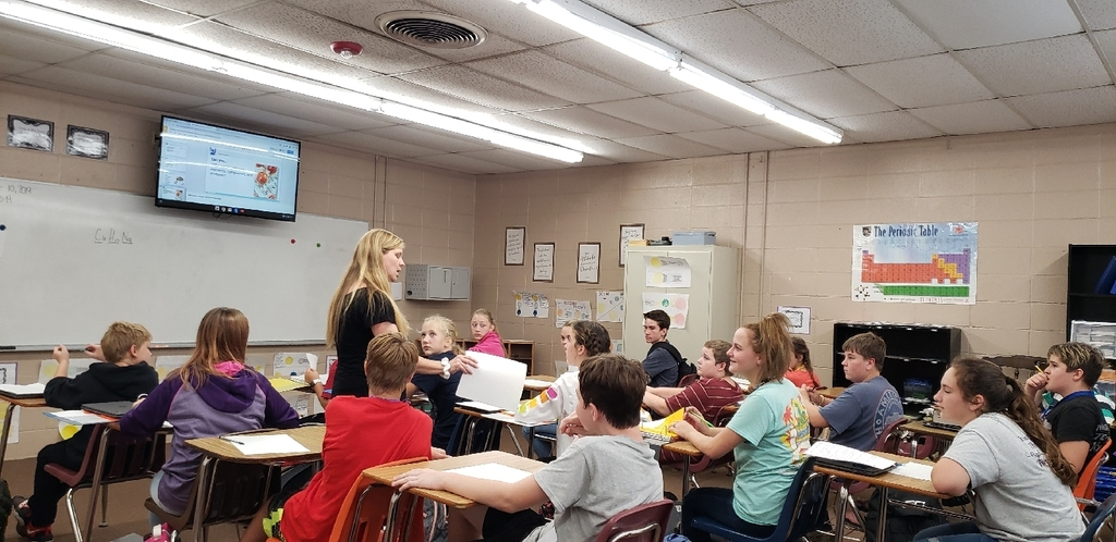 Mrs. White preparing her 7th grade science class for their upcoming test.