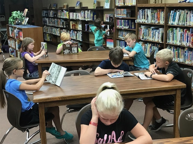 Fourth graders enjoying their library books!